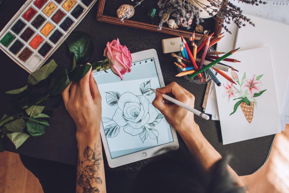 A digital artist creating art on a computer tablet