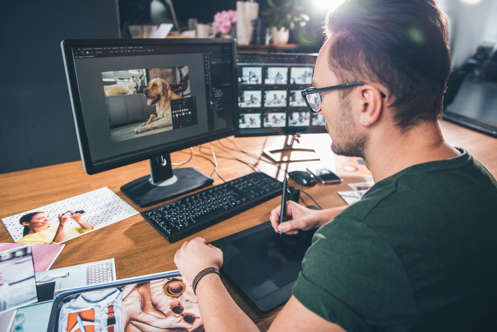 A digital artist creating art on a computer